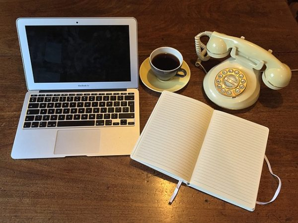 old-fashioned-telephone-notebook-and-coffee-when-ordering-food-delivery